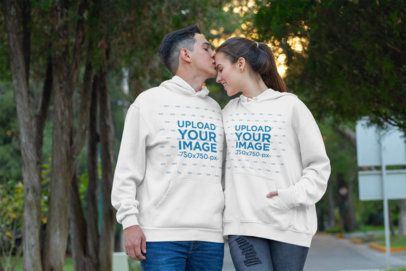 Pullover Hoodie Mockup of a Couple Kissing at the Park 30756