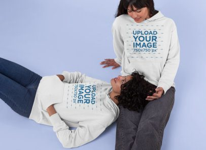 Pullover Hoodie Mockup Featuring a Couple Lying on the Floor 30402