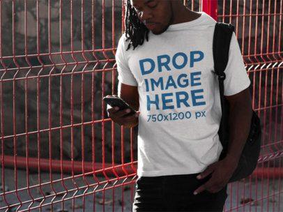 Tee Mockup of a Black Man With Dreadlocks Using His Smartphone b8773