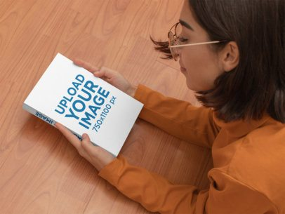 Paperback Book Mockup Featuring a Woman Lying on the Floor 31044