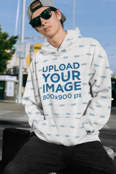 Mockup of a Young Man Wearing a Sublimated Hoodie 31129