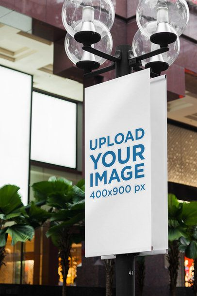 Mockup of a Vertical Banner Placed on a Street Light Pole 2306-el1