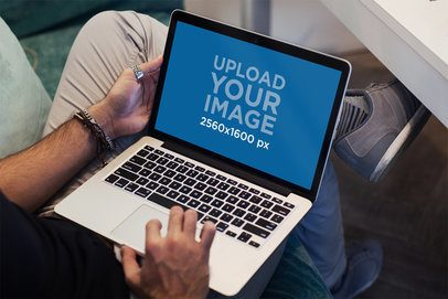 MacBook Pro Mockup Featuring a Modern Man Using His Computer 2318-el1