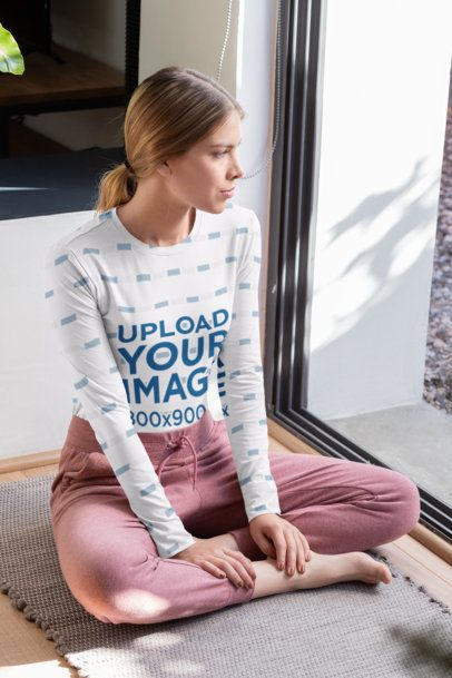 Sublimated Long Sleeve Tee Mockup of a Young Woman Sitting Next to a Window 31259