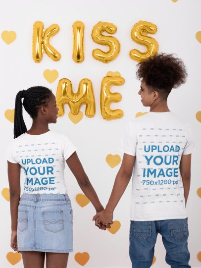 Back View T-Shirt Mockup Featuring a Young and Happy Couple Holding Hands 31222