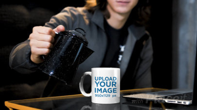 Video of a Man Pouring a Hot Drink Into a Coffee Mug 31580