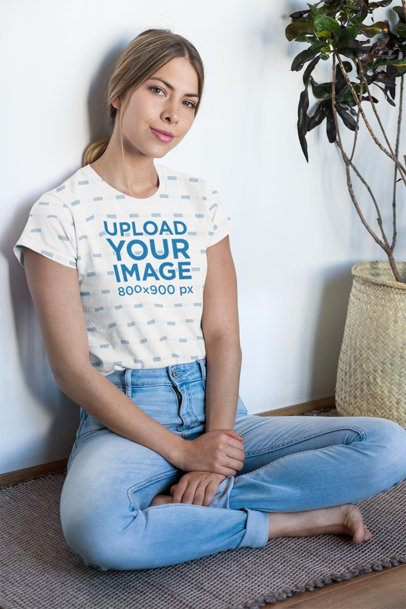 Sublimated T-Shirt Mockup of a Woman Sitting by a Plant 31270