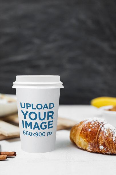 Mockup of a Coffee Cup Next to a Croissant 2179-el1