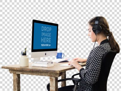 iMac PNG Mockup of a Woman Working While Listening to Music a11695