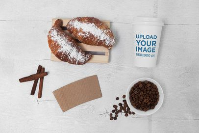 Mockup of a Coffee Cup Placed by Some Coffee Beans and Food 2185-el1