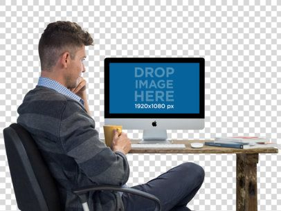 iMac Mockup Featuring a Young Man With His Coffee a11726
