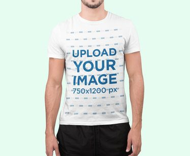 T-Shirt Mockup of a Man Standing at a Studio 2367-el1