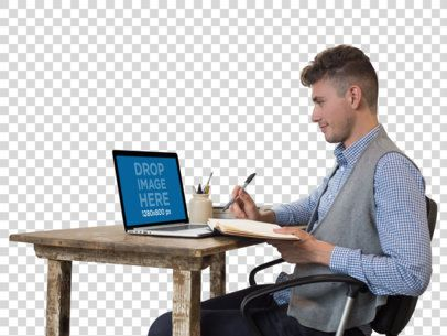 MacBook Pro Mockup of a Man Writing in His Notebook a11720