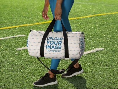 Duffle Bag Mockup Featuring a Woman at a Soccer Field 31353