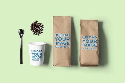 Mockup of a Coffee Cup Next to Two Coffee Bags 2628-el1