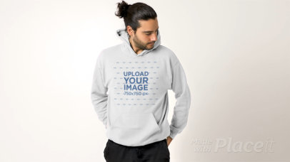 Pullover Hoodie Video Featuring a Serious Man Posing Against a Plain Background 32031