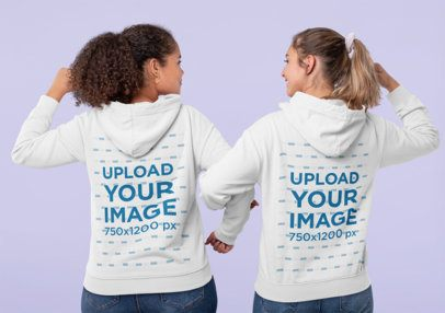 Hoodie Mockup of Two Women Making a Strong Pose Together 31999