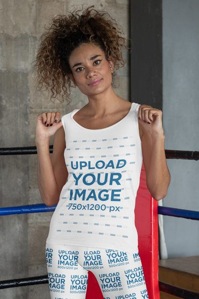 Mockup of a Woman Showing Off Her Tank Top and Leggings at a Boxing Gym 31365