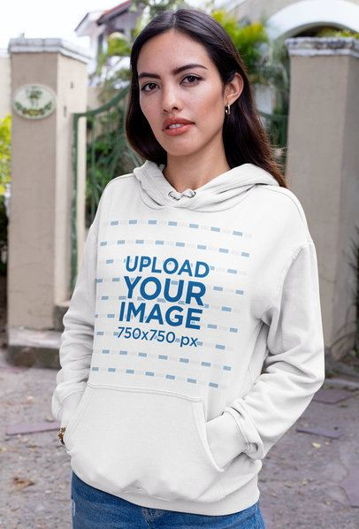 Mockup of a Brunette Woman Wearing a Pullover Hoodie on the Street 32063
