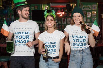 T-Shirt Mockup of Three Friends Celebrating St. Patrick's Day at a Bar 32132