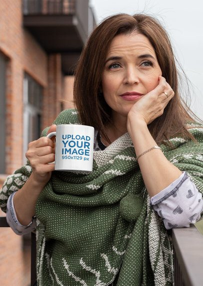 Mockup of a Middle-Aged Woman Holding an 11 oz Coffee Mug Outside 31600