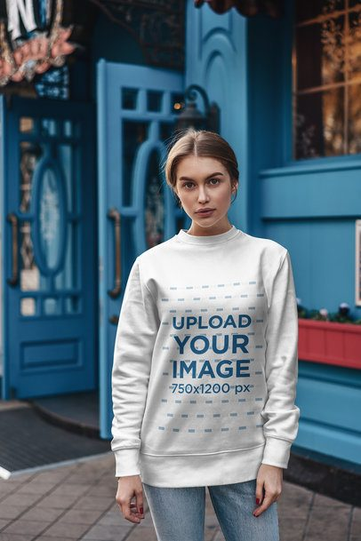 Sweatshirt Mockup of a Woman Posing Outside a Blue Building 2832-el1