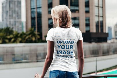 Back View Mockup of a Woman Wearing a T-Shirt in an Urban Scenario 2822-el1