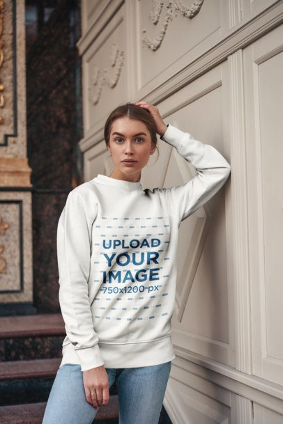 Sweatshirt Mockup of a Young Woman Posing Next to a Fancy-Looking Wall 2835-el1
