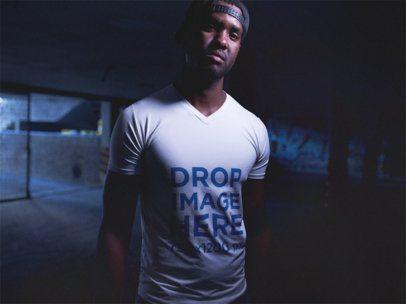 V-Neck T-Shirt Mockup Featuring a Black Man Wearing a Snapback Hat a12146