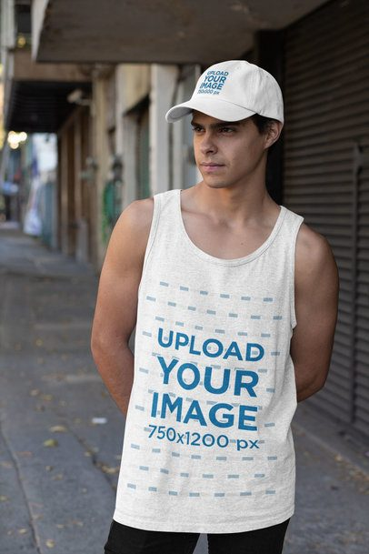 Mockup of a Young Serious Man Wearing a Dad Hat and a Heather Tank Top 31176