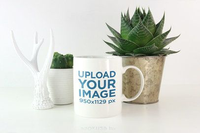 Coffee Mug Mockup Featuring Some Plants and a Decoration Piece 2950-el1