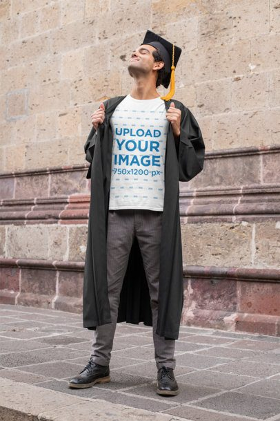 T-Shirt Mockup Featuring a Proud Young Man Wearing a Graduation Gown 32629