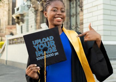 Mockup of a Young Woman Pointing at Her Graduation Cap 32597