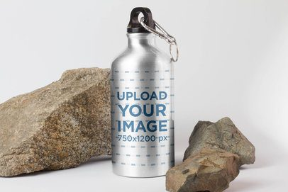 Mockup of an Aluminum Bottle Surrounded by Rocks 3085-el1