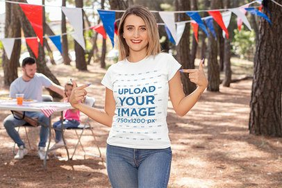 Mockup of a Woman Showing Off Her T-Shirt on a 4th of July Celebration 33029
