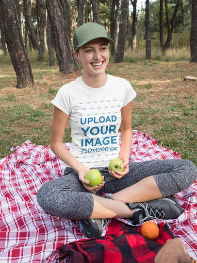 T-Shirt Mockup of a Woman Holding Some Apples 32236