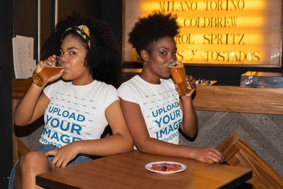 T-Shirt Mockup of Two Women Drinking Beer at a Bar 32307