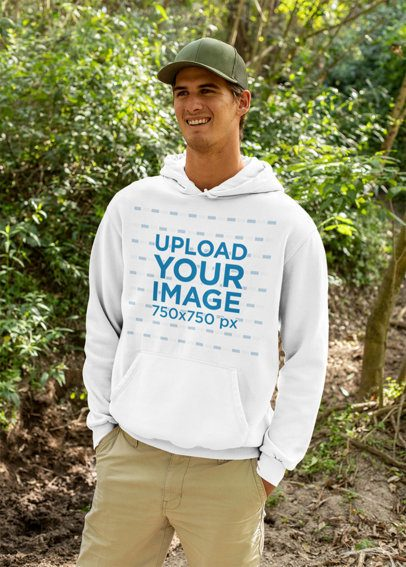 Mockup of a Happy Man Wearing a Hoodie in the Woods 32227