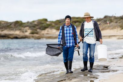 T-Shirt Mockup of Two Fishermen Walking by the Sea 3236-el1