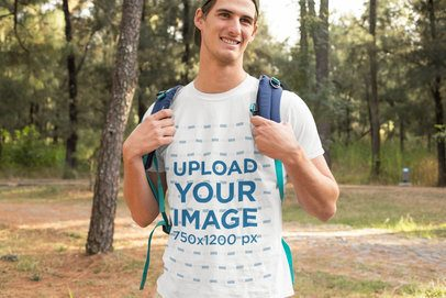 T-Shirt Mockup Featuring a Smiling Man Hiking at the Woods 32242
