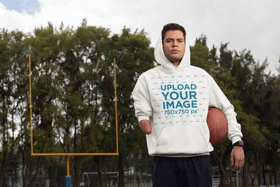 Pullover Hoodie Mockup of a Serious Man in a Football Field 32498