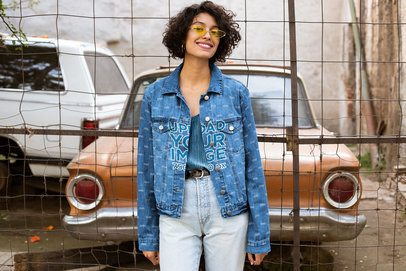 Mockup of a Happy Woman Wearing a Denim Jacket in a Vintage Setting 32566