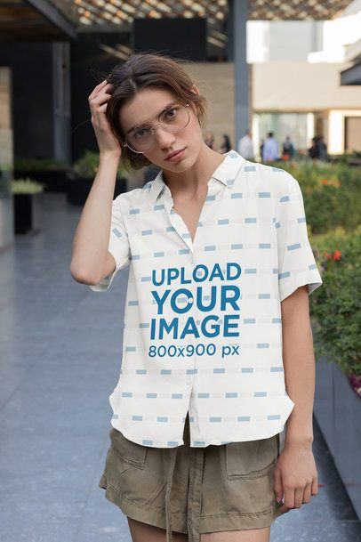 Mockup of a Young Woman Wearing a Customizable Button-Up Shirt 33138