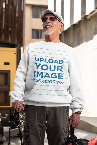T-Shirt Mockup of a Senior Man with Sunglasses Holding a Camera 32882