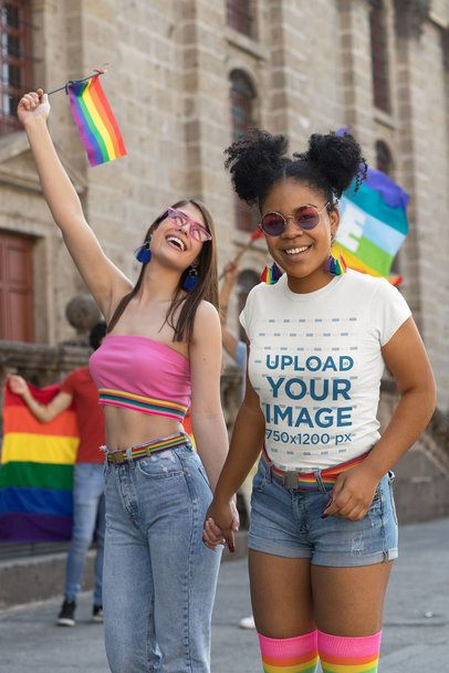 T-Shirt Mockup of a Woman Holding Another Woman's Hand at Pride Parade 32986