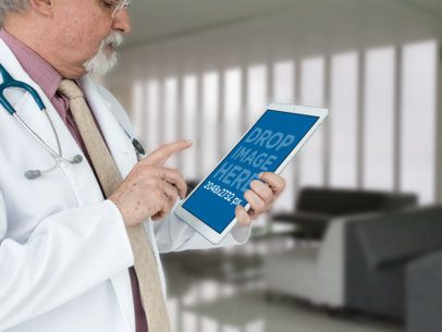 Mockup Featuring a Senior Doctor Using an iPad Pro 12436