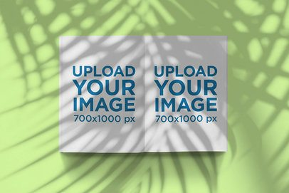 Mockup of an Open Magazine Under a Palm Shadow 2462-el1