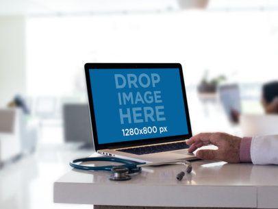 Mockup of a Senior Doctor Working in a MackBook 12443