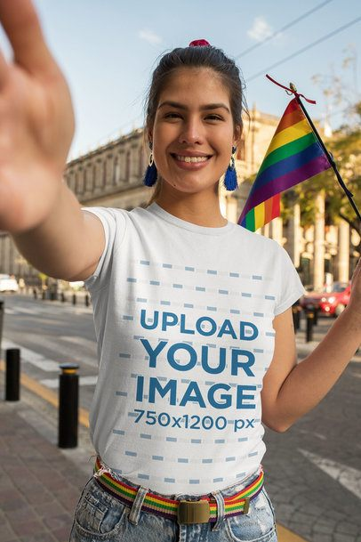 Selfie Mockup Featuring a Woman with a Crewneck T-Shirt Holding a Rainbow Flag 32998
