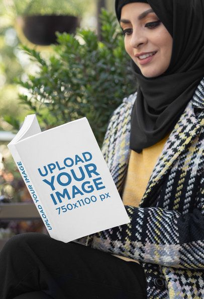 Mockup of a Woman in a Hijab Holding a Paperback Book 32411